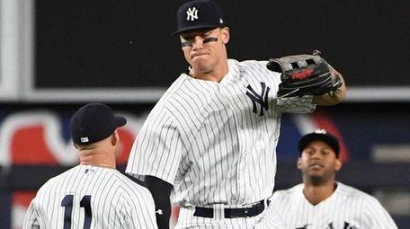 New York Yankees rightfielder Aaron Judge, center, celebrates