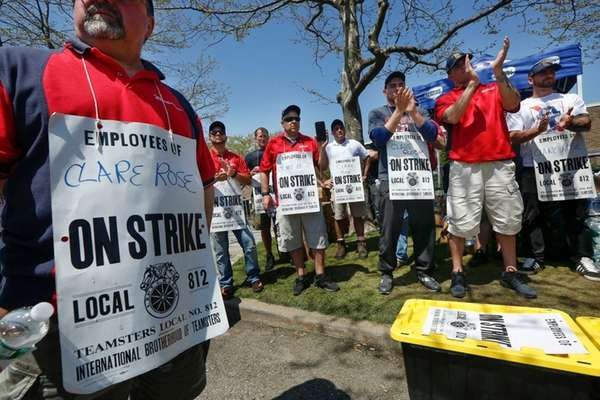 Striking employees join the picket line outside the