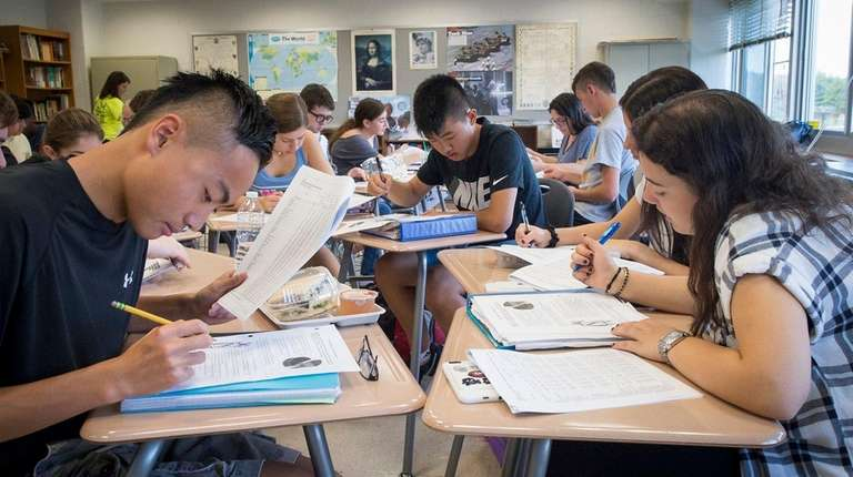 Jericho High School students work on class assignments