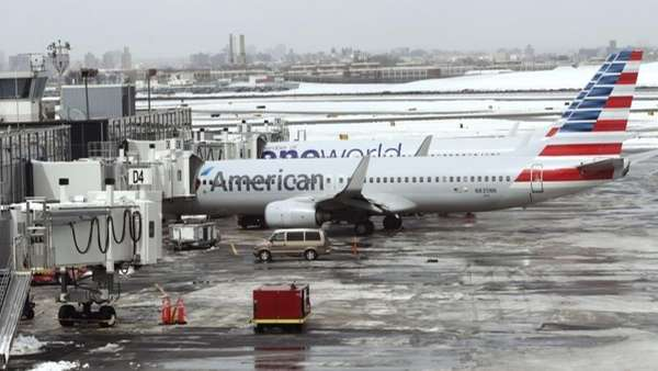 American Airlines airplanes sit on the tarmac at