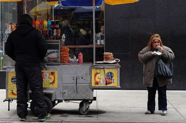 A woman eats her lunch purchased from a