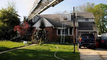 Firefighters battled a house fire on North Delaware