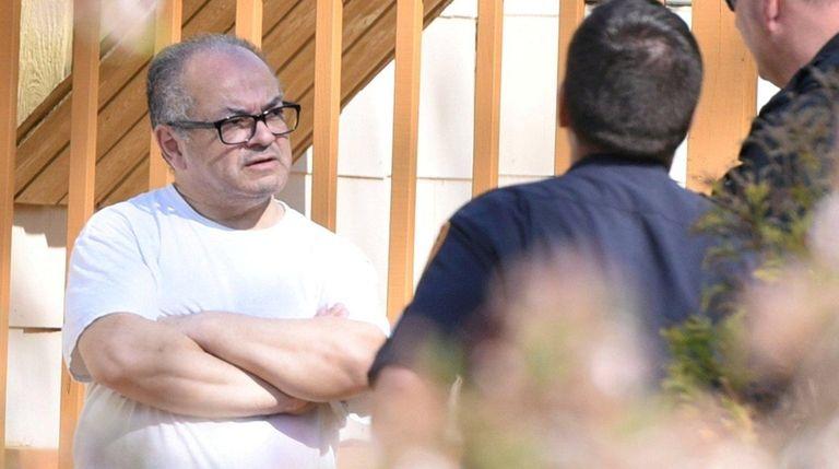 Cesar Gonzales-Mugaburu, talks to a Suffolk County police