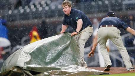 Members for the Atlanta Braves grounds crew work