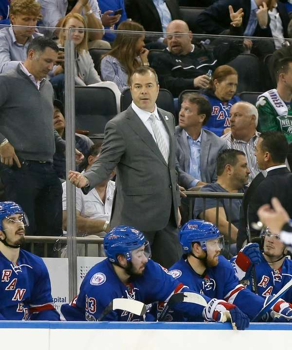 Alain Vigneault of the New York Rangers stands