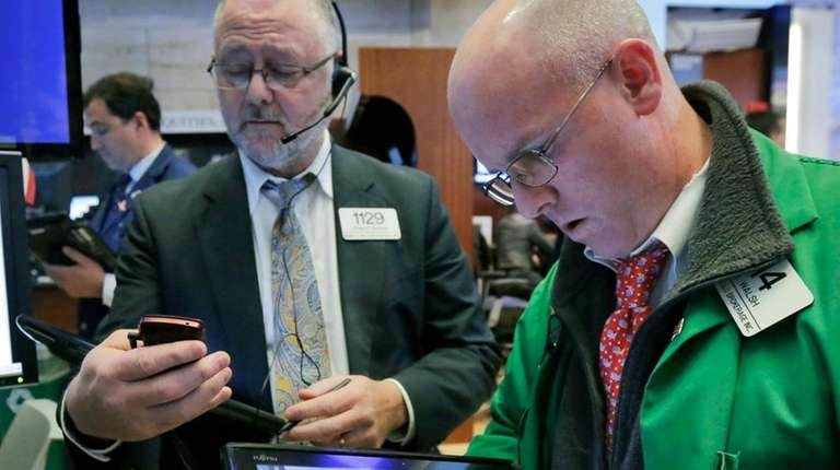 Traders Robert Moran, left, and Kevin Walsh work