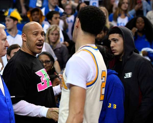 UCLA guard Lonzo Ball, right, shakes hands with