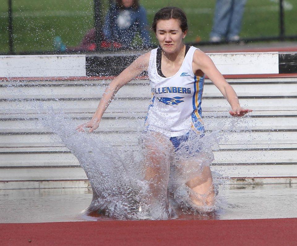 Julia Bryant of Kellenberg goes over a hurdle