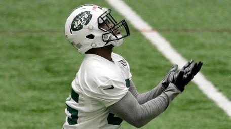 New York Jets' Elijah McGuire receives a punt