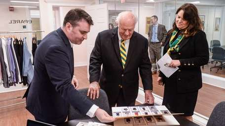 Kevin Schiesz, CEO of uniform company eParel, shows