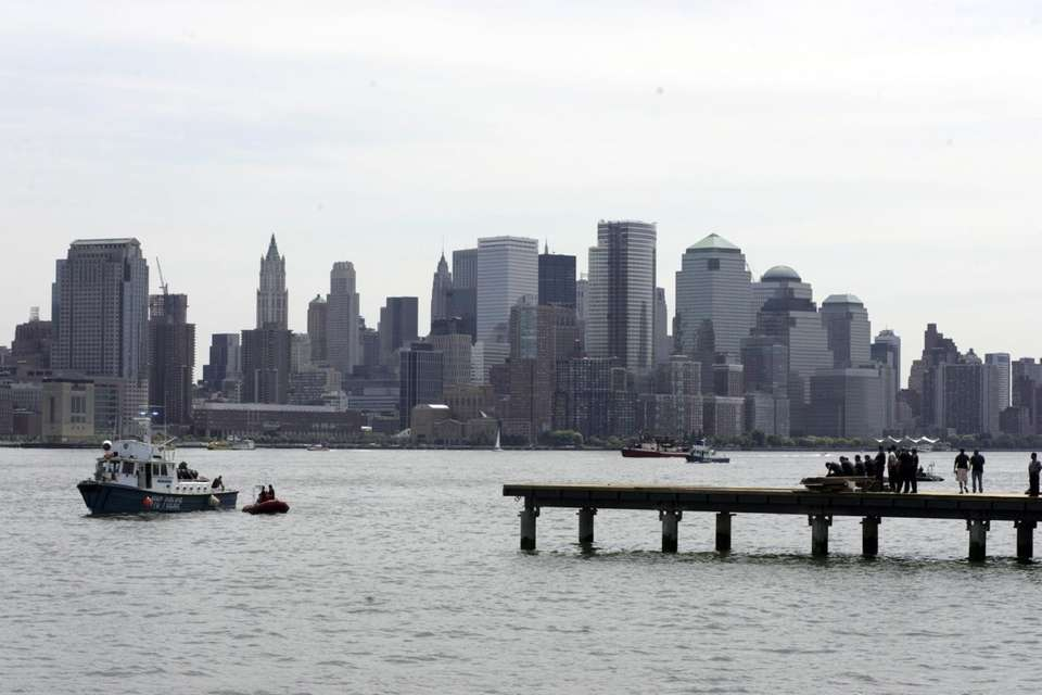 Rescuers search in the Hudson River after a