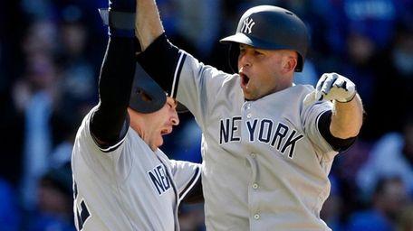New York Yankees' Brett Gardner, right, celebrates with