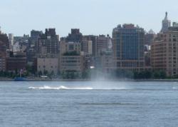 A splash rises from the Hudson River where