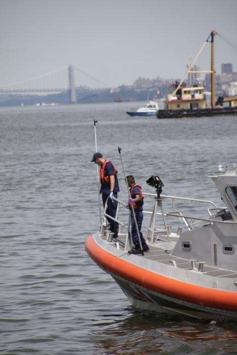 Rescue workers look for debris and possible survivors