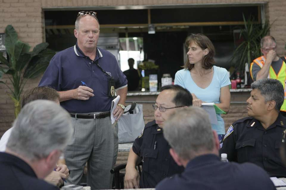 Hoboken mayor Dawn Zimmer, right, background is briefed