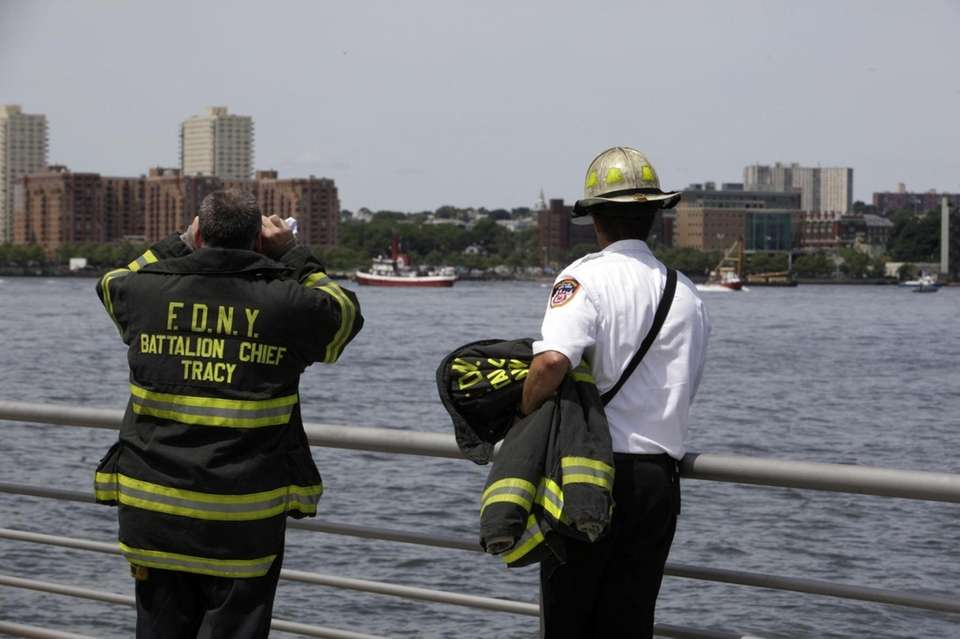 Firefighters survey the scene of a helicopter crash