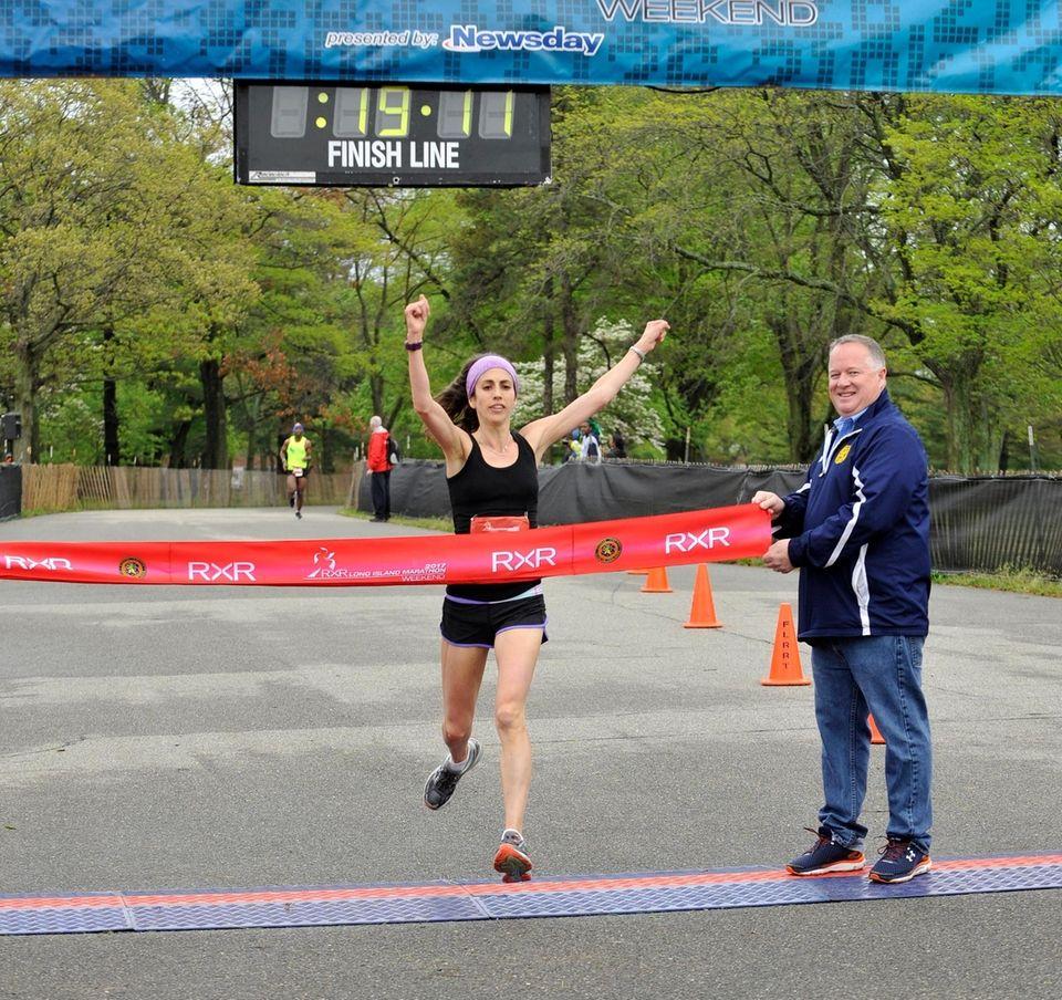 Shari Klarfield, of Plainview, crosses the finish line