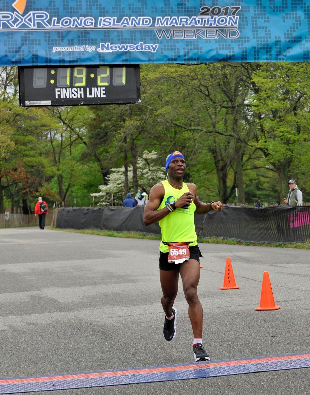 Trent Hampton, of Lake Ronkonkoma, crosses the finish