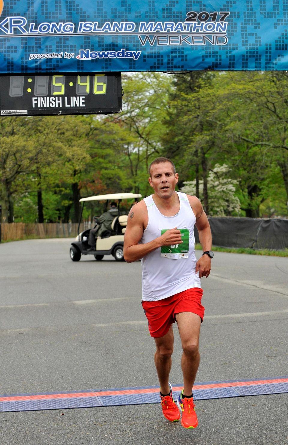 Jason Ramirez, of Wantagh, crosses the finish line