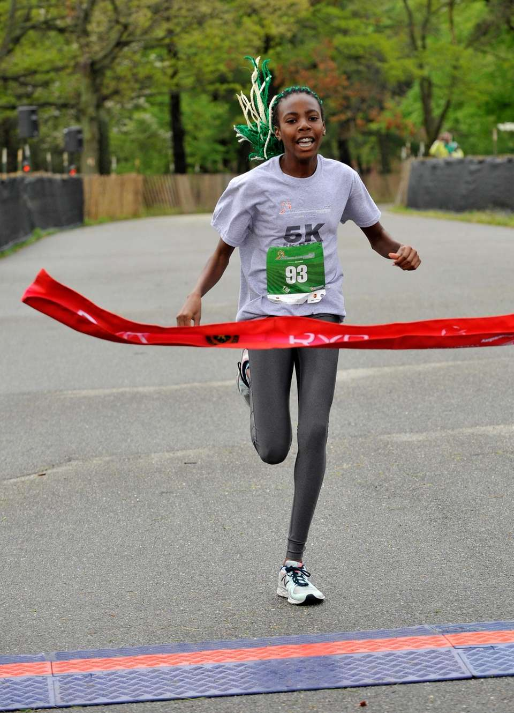 Leann Nicholas, 13, of Farmingdale, crosses the finish