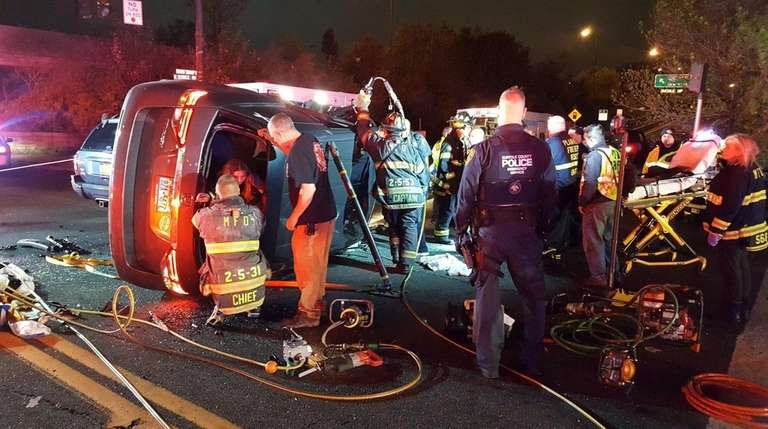 Rescuers help a victim of a vehicle crash