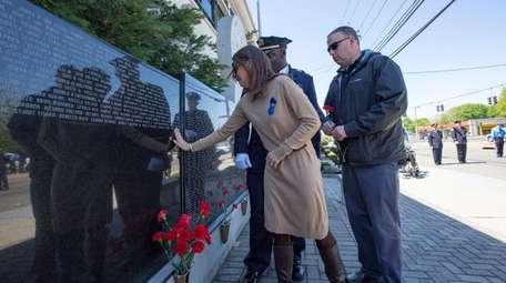 Lisa Tuozzolo, the wife of fallen NYPD sergeant,