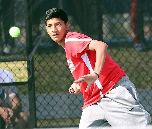 Syosset's Neel Rajesh plays against Roslyn's Dan Weitz