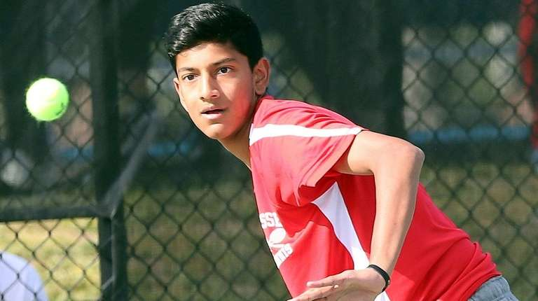 Syosset's Neel Rajesh plays against Roslyn's Dan Weitz