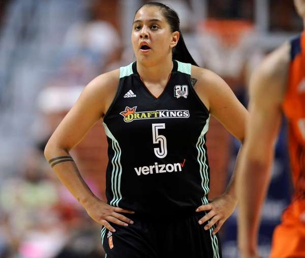 New York Liberty's Shoni Schimmel watches during the