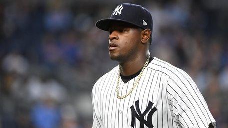 New York Yankees starting pitcher Luis Severino walks