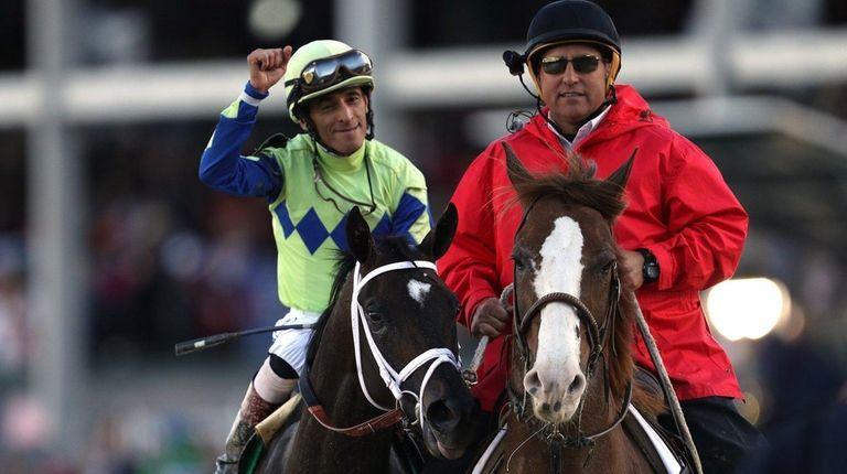 Jockey John Velazquez celebrates atop Always Dreamingafter winning