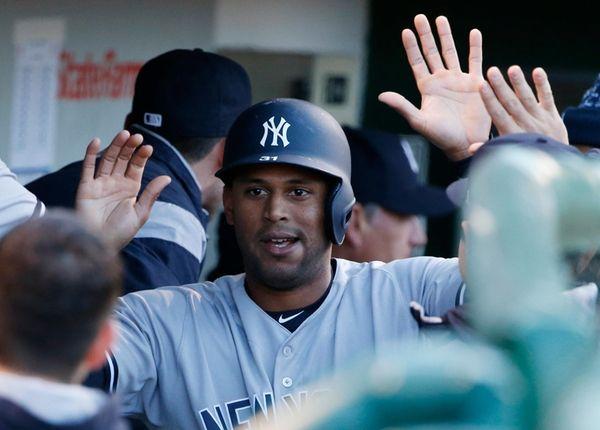 New York Yankees' Aaron Hicks celebrates with teammates