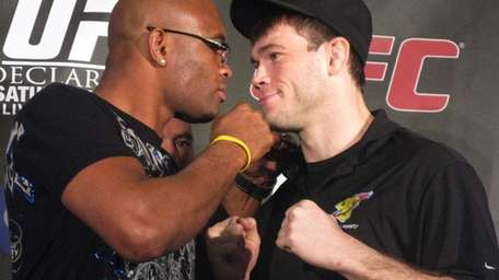 UFC middleweight champion Anderson Silva, left, and former
