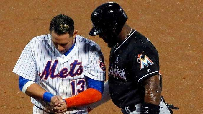 Marcell Ozuna of the Miami Marlins checks on Asdrubal
