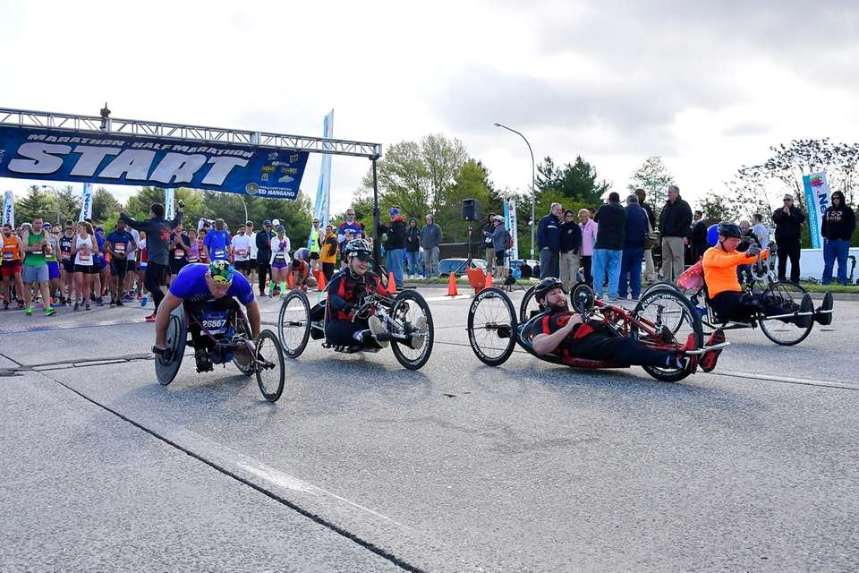Hand-cyclists participating in the Long Island Marathon take