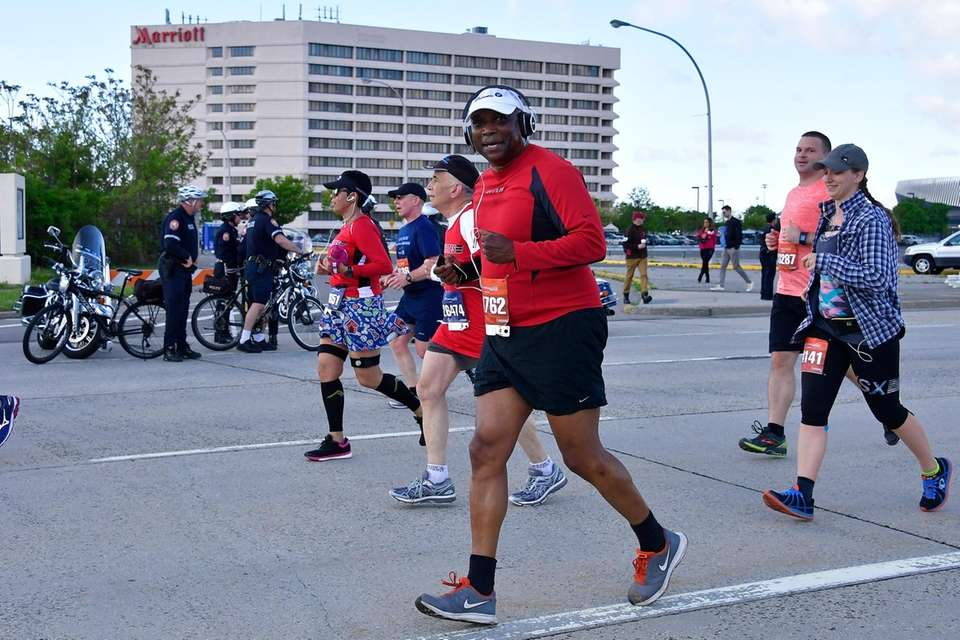 Race participants run on Charles Lindbergh Boulevard in