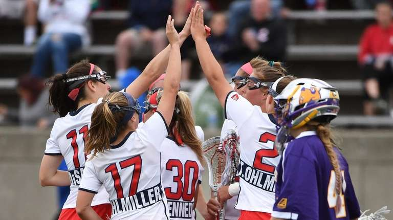 Stony Brook players celebrate a goal as Albany