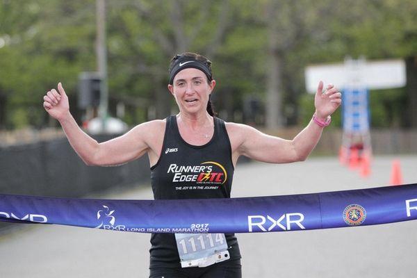 Long Island Woman's 10K winner Kelly Perno-Grosser crosses