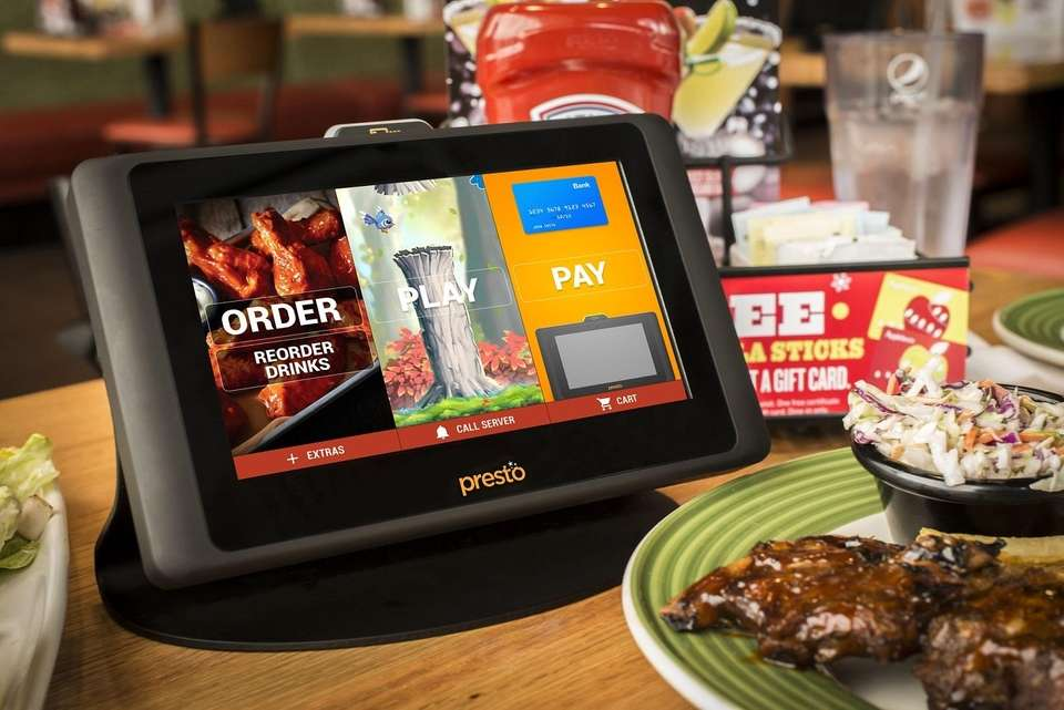 At Applebee's, tabletop tablets are placed in seating