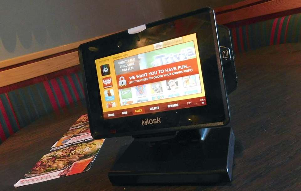 Red Robin eateries feature tabletop tablets placed in