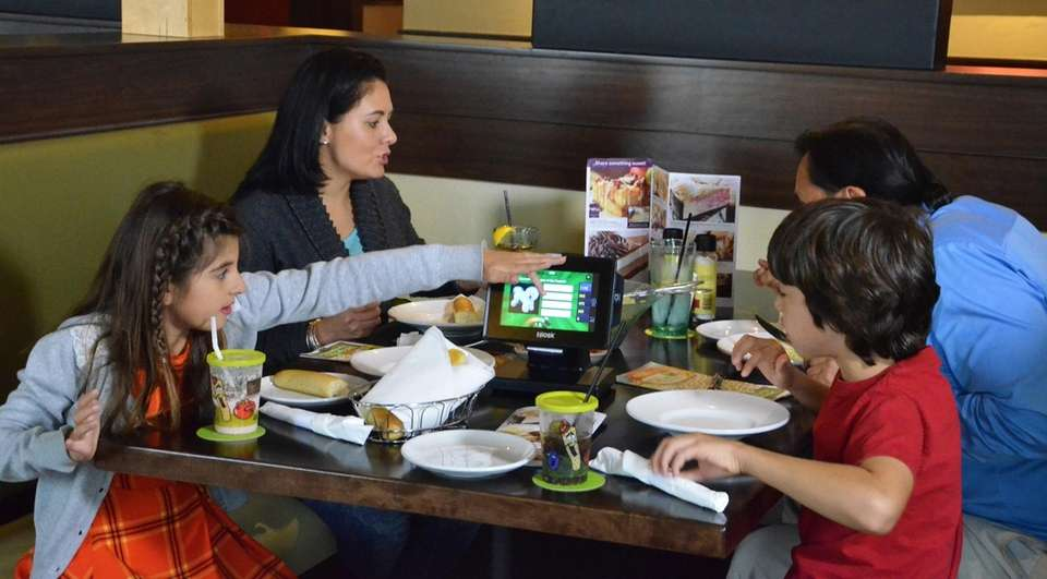 At Olive Garden, tabletop tablets are placed in