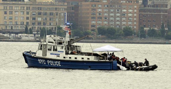 HOBOKEN, NJ - AUGUST 9: Divers unload a