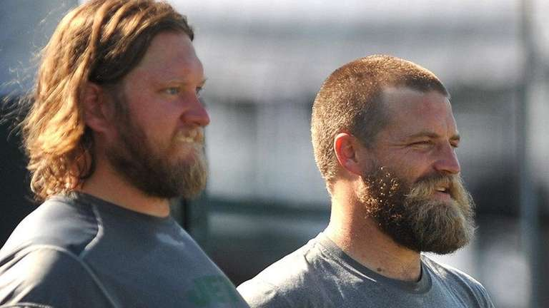 Ryan Fitzpatrick #14, right, stands alongside teammate #74