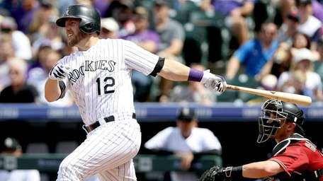 Mark Reynolds #12 of the Colorado Rockies hits