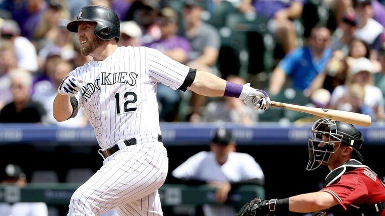 Mark Reynolds #12 of the Colorado Rockies hits