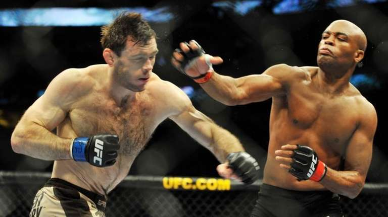 PHILADELPHIA - AUGUST 08: Anderson Silva (R) throws