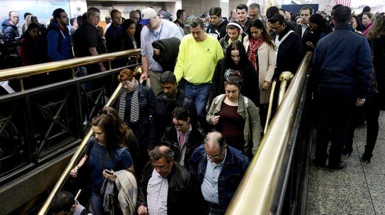 Long Island Rail Road passengers enter the staircase