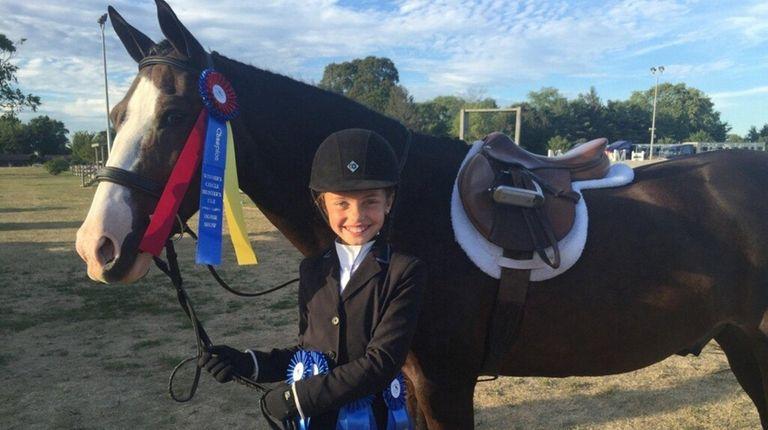 Amberly Szczerbiak, 10, is having a blue ribbon