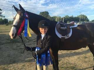 Amberly Szczerbiak, 10, is having a blue ribbon