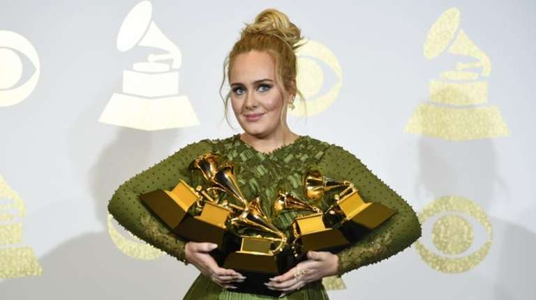Adele in the press room with the awards